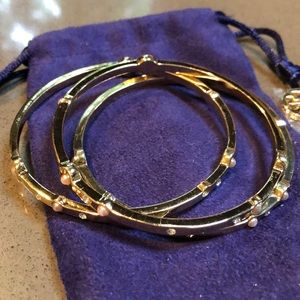 Set of three gold bracelets with pearl accents
